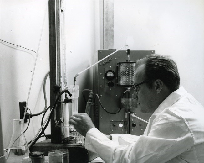 Lab tech working in sinter plant laboratory to check chemistry of ore samples – 1965. Sault Ste. Marie Public Library archive photo