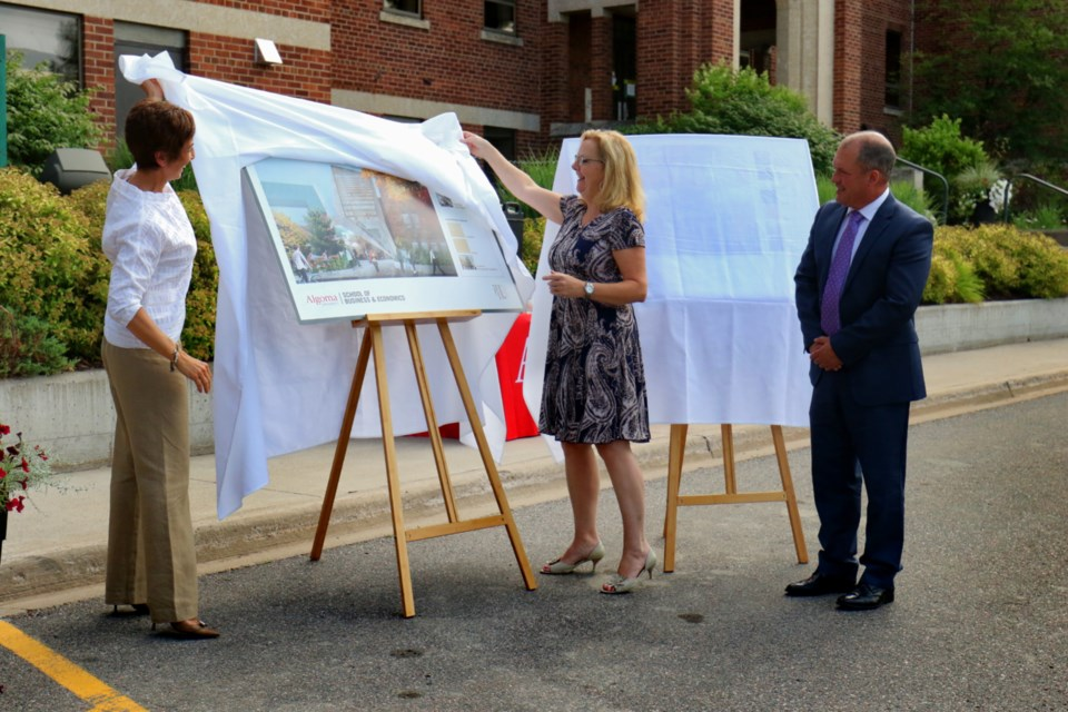 Algoma University president Asima Vezina, School of Business and Economics director Cathy Denomme and board of governors chair Mark Nogalo unveil conceptual drawings for the university's new School of Business & Economics Tuesday. James Hopkin/SooToday