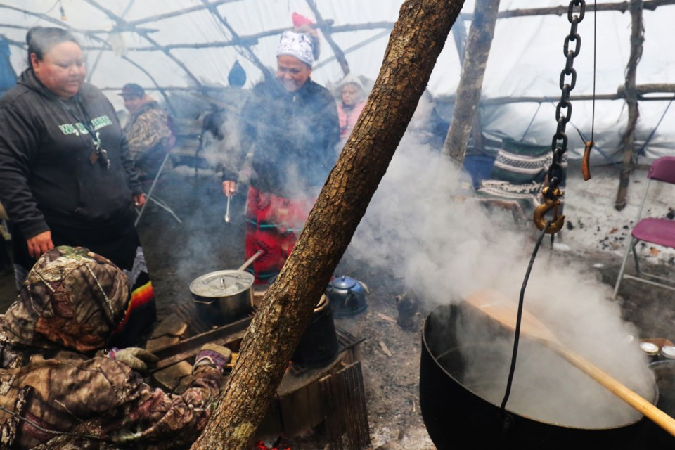 People have been coming to the teaching lodge behind Shingwauk Kinoomaage Gamig to make maple syrup over the past three weeks. Collecting sap from the nearby sugar bush and boiling it down to maple syrup is a tradition going back more than three decades. James Hopkin/SooToday
