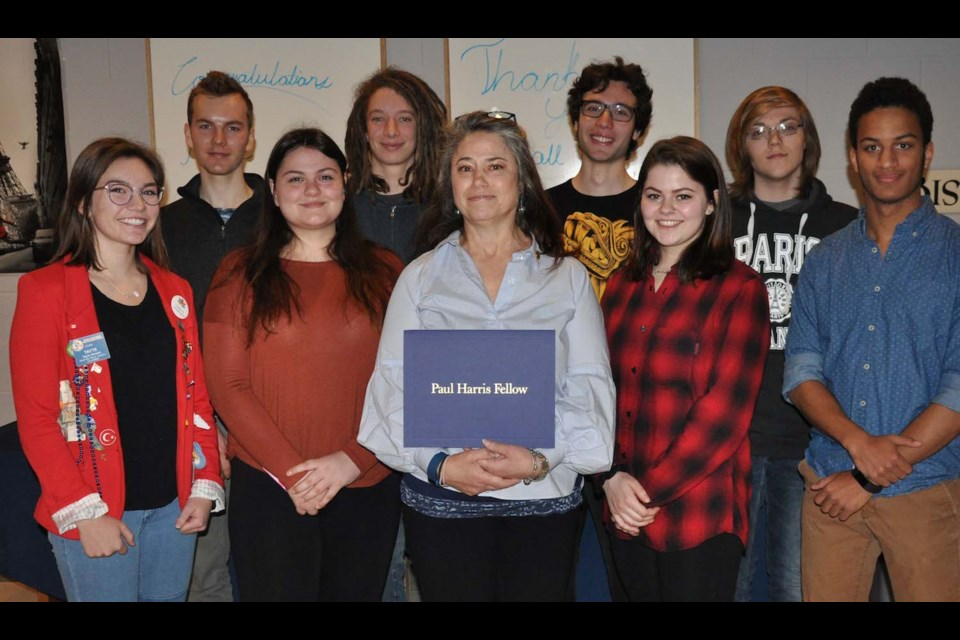 Jill Inch, teacher at Superior Heights, surrounded by many of her World Issues students at Rotary presentation held in her honour. Photo provided
