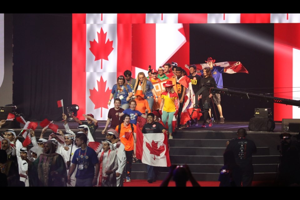 The Canadian team reps pass through the wall of flags that lights up with the Maple-Leaf during the opening ceremonies, immediately following the teams from Bahrain. Photo provided