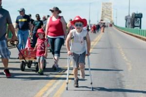 Camden uses crutches to make it over the International Bridge <b>(14 photos)</b>