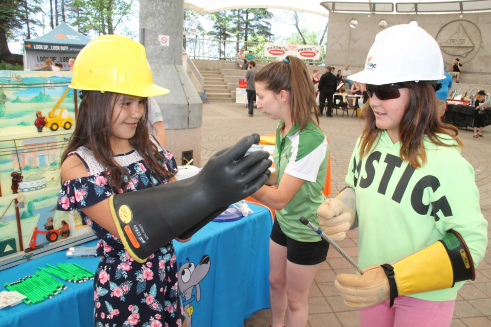 Children try on PUC protective personal equipment at the annual Kidz Summer Safety Festival held at the Roberta Bondar Pavilion, June 23, 2019. Darren Taylor/SooToday