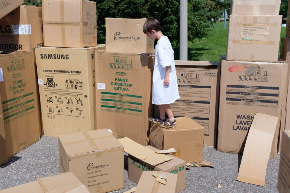 gigantic cardboard box fort is a metaphor for bored youth 5