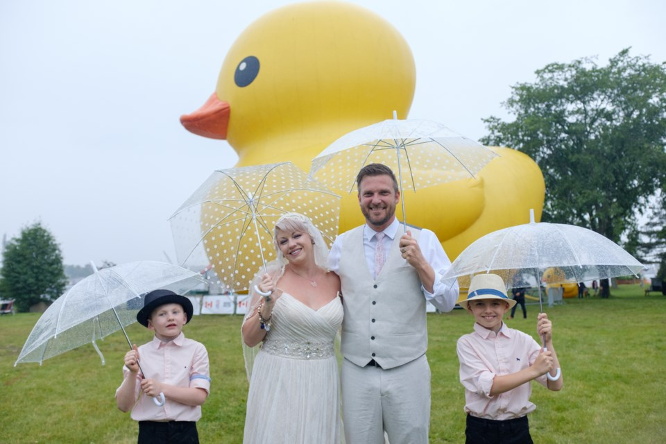 Steph Knight and Todd Knight —  accompanied by Jonas, 8, (left) and Damian, 10, (right) — posed in front of the World's Largest Rubber Duck a half an hour before the couple were to be married on Thursday. Jeff Klassen/SooToday
