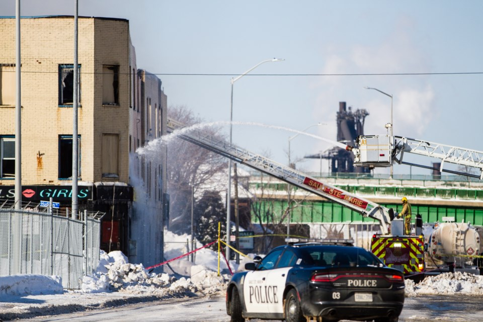 Firefighters remain at the scene of a fire that broke out early Monday morning at The Dime, formerly Studio 10, on Queen Street West. Donna Hopper/SooToday