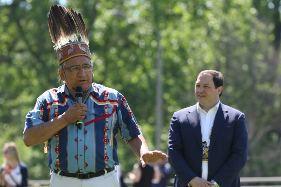Batchewana First Nation Chief Dean Sayers, left, offers welcoming remarks during National Anishinaabe Day festivities while Mayor Christian Provenzano looks on. James Hopkin/SooToday