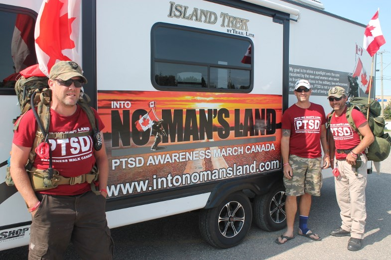 Scott McFarlane, Jason McKenzie and Steve Hartwig with their Into No Man's Land trailer