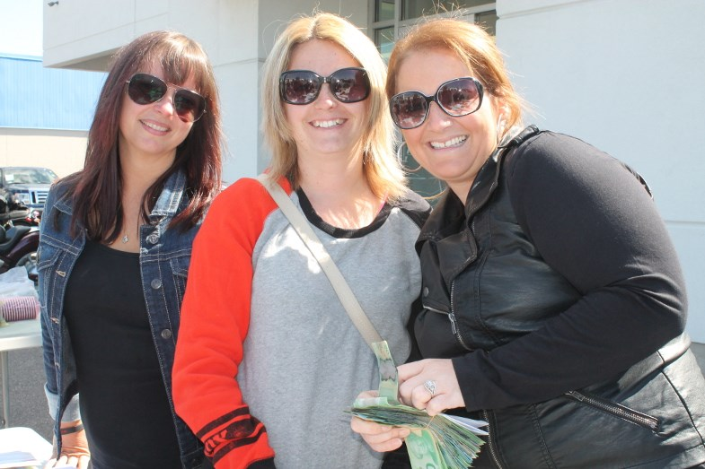 At the registration desk, Nicole Bangs, Sharon Hunt, Jessie Boston