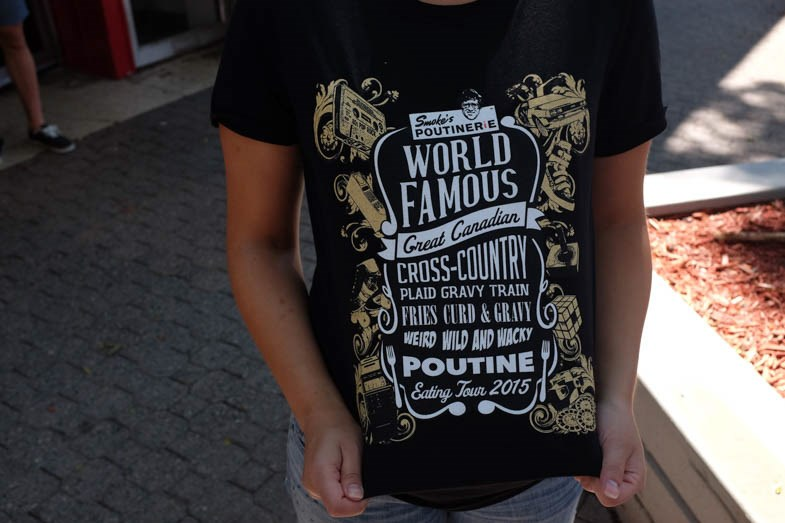 A t-shirt at Smoke's World Famous Great Canadian Cross Country Plaid Gravy Train Fries Curds & Gravy Weird Wild and Wacky Poutine Eating Tour 2015 on July 25th, 2015 in Sault Ste. Marie. Jeff Klassen for SooToday