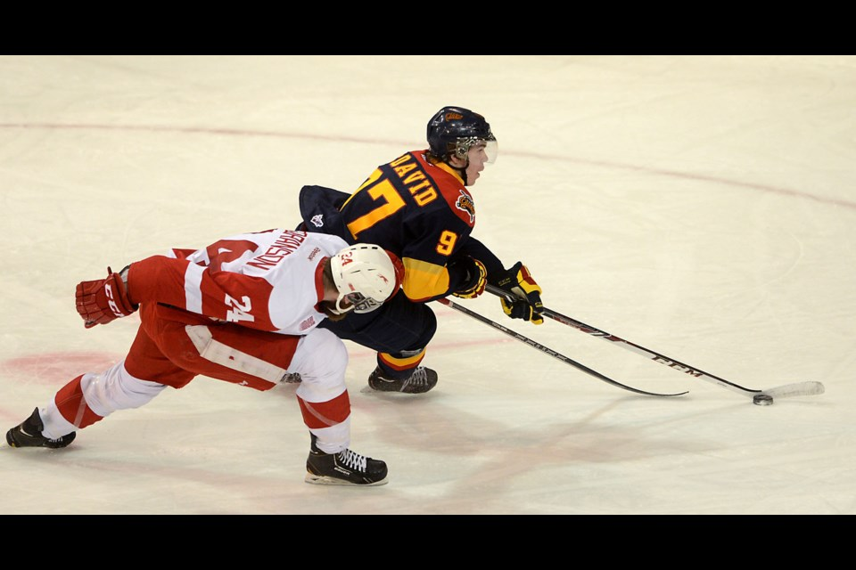 Alex Gudbranson of the Sault Ste. Marie Greyhounds tries to slow down Connor McDavid of the Erie Otters in the first period of Game 4 of the OHL Western Conference semi finals at Erie Insurance Arena on April 8. JACK HANRAHAN/