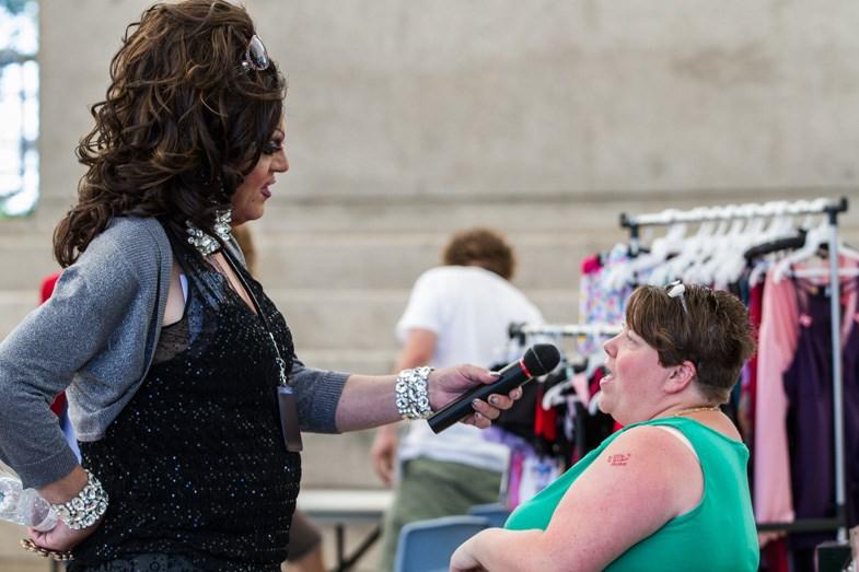 Event emcee Gia Diamond speaks with vendors during the Sault Pridefest 2014 Loud and Proud community celebration at the Bondar Pavilion on Sunday, September 7, 2014. Donna Hopper/SooToday.com