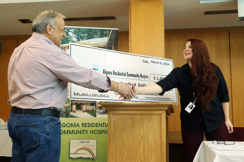 City CEO Joe Fratesi presents an oversized cheque to Lee Skinner from ARCH.