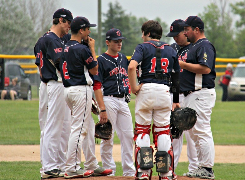 The Gladstone Indians talk strategy between hitters