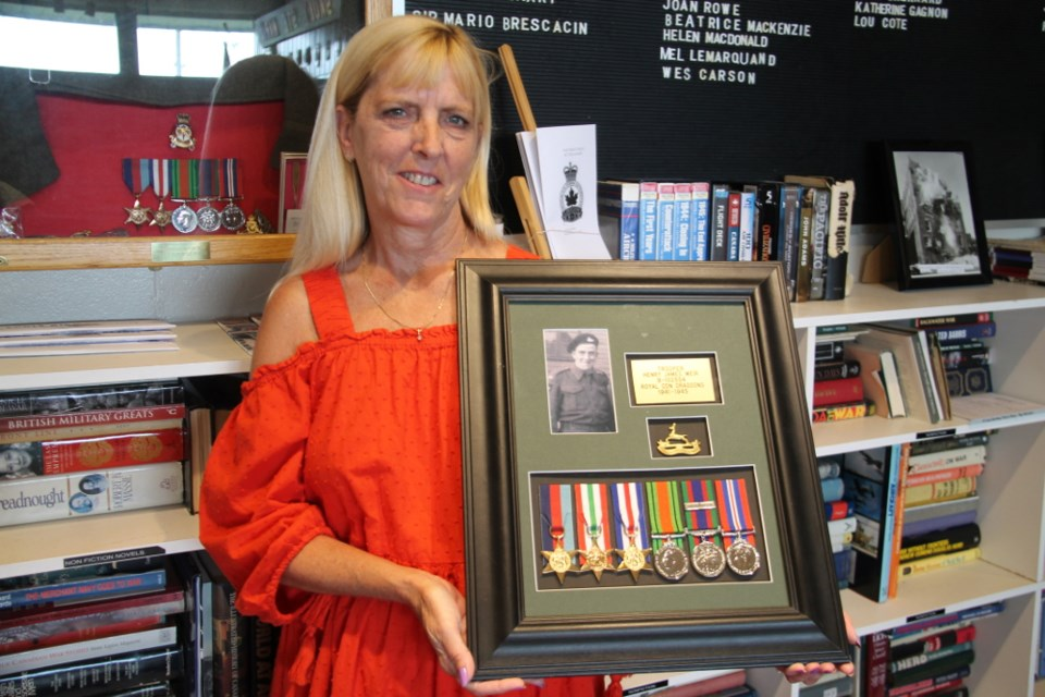 The Sault's Margaret Durkee with her father Henry Weir's recovered Second World War items.  The items were lost, but discovered and handed over to Royal Canadian Legion Branch 25.  Darren Taylor/SooToday