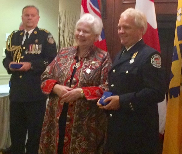 Brian Haines, Sault Ste. Marie paramedic, at right, received a 2017 Emergency Medical Services Exemplary Service Medal (first bar, for 30 years of service) from Ontario Lieutenant Governor Elizabeth Dowdeswell at a ceremony in Toronto, Oct. 23, 2017. Photo supplied.