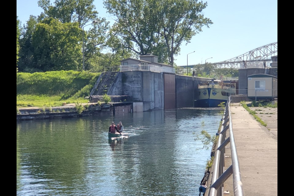 Dave and Dan Gardner clear the historic lock at the Sault Ste. Marie Canal National Historic Site.