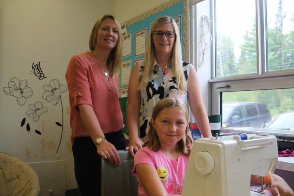 Mountain View Public School teachers Nikki Burke and Melissa Rains-Vanderburg with student Brooke Irving, one of a group of students sewing dresses for African girls in need, June 28, 2018. Darren Taylor/SooToday