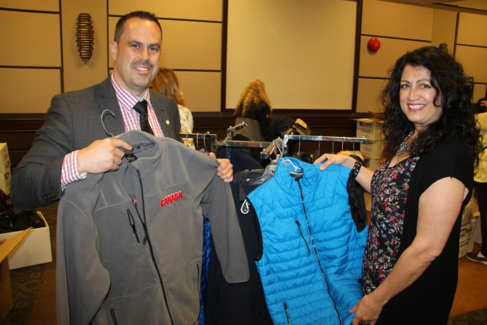 Sonny Spina, Algoma Family Services Foundation chair, and Sherry Berlinghoff, SK Group president, with new, high quality clothing made available to local charities, May 24, 2019. Darren Taylor/SooToday