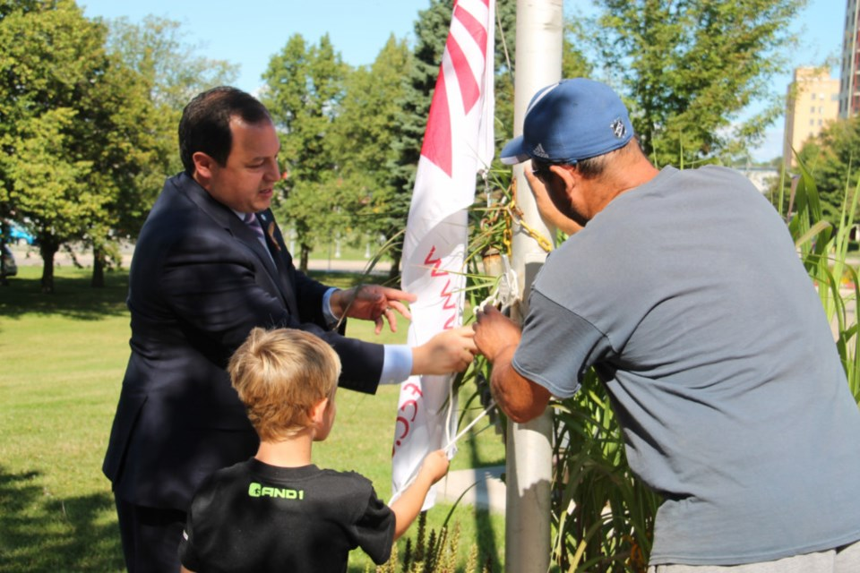 Sault Mayor Christian Provenzano with Terrance Boston, 10, a child currently in remission after battling cancer, and Dominic Campioni, whose daughter Angela passed away from childhood cancer, raising the Northern Ontario Families of Children with Cancer (NOFCC) flag prior to proclaiming September to be Childhood Cancer Awareness Month in Sault Ste. Marie, Sept. 10, 2018. Darren Taylor/SooToday