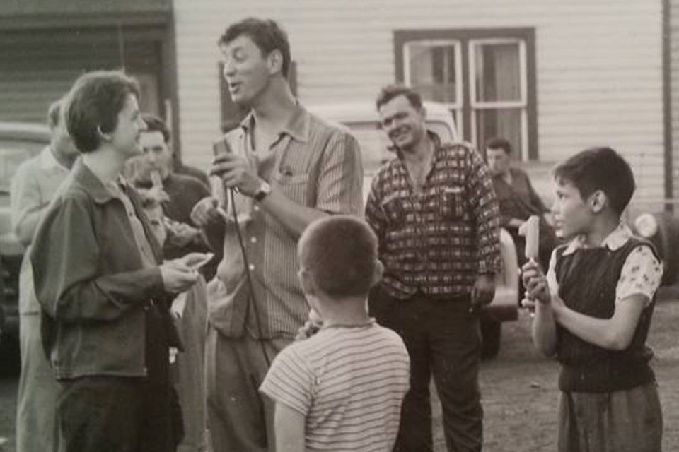 Uncharacteristically mustacheless, a young George Jonescu waxes eloquent during a CJIC remote broadcast in 1950s Sault Ste. Marie