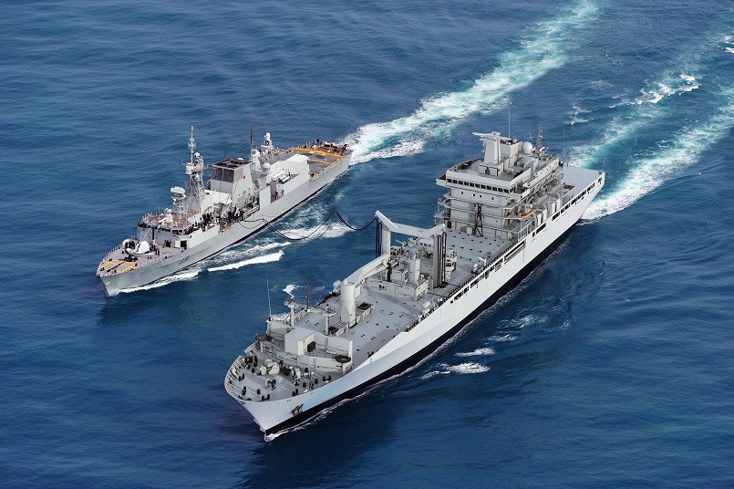Artist's rendering of the future Protecteur-class joint supply ship (at right) replenishing a smaller Canadian vessel at sea