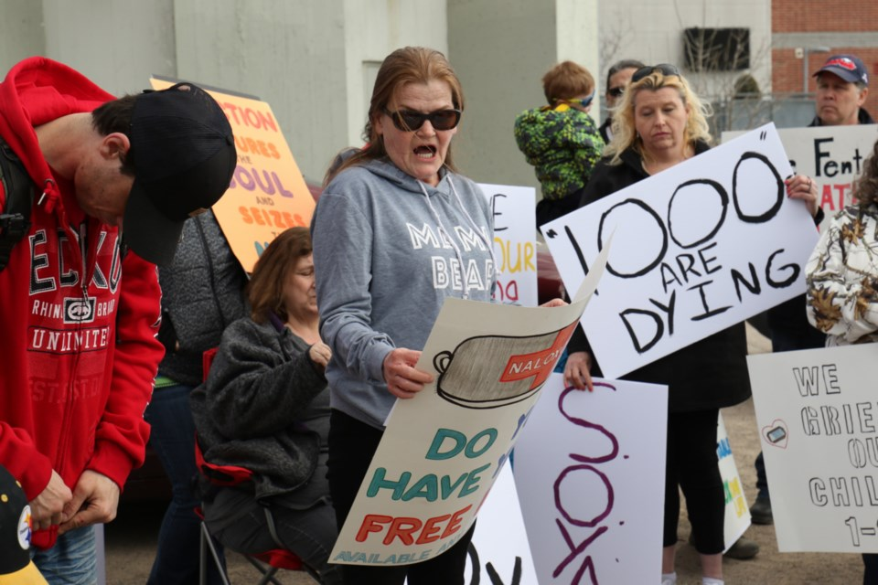 Connie Raynor-Elliott of Save Our Young Adults (SOYA) reads a prepared speech during the National Day of Action on the Overdose Crisis event Tuesday. James Hopkin/SooToday