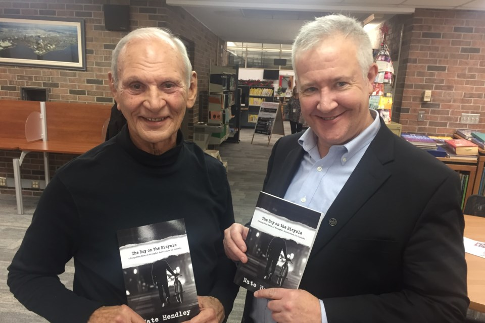Ron Moffatt with true-crime author Nate Hendley at James L. McIntyre Public Library on Nov. 24, 2018. David Helwig/SooToday