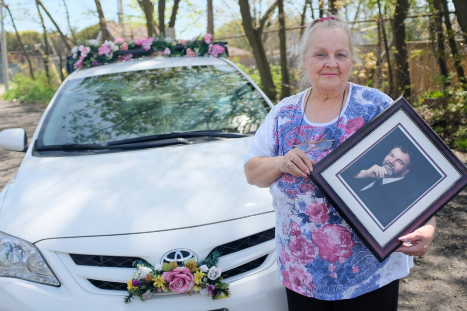 15 years ago, Carolyn Chisholm started putting flowers on her car to cheer up patients on dialysis, including her husband Walter Chisholm Jr.. Ever since Walter died in 2005, she has continued doing it in his honour. Jeff Klassen/SooToday