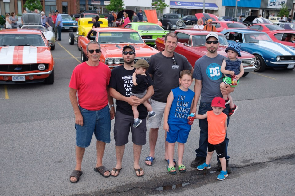 The Lepore family in front of just four of their vintage Chevrolet cars. (From left) Gino, Josh, Carson, Jeff, Lucas, Matthew, Logan, and Marcus. Jeff Klassen/SooToday