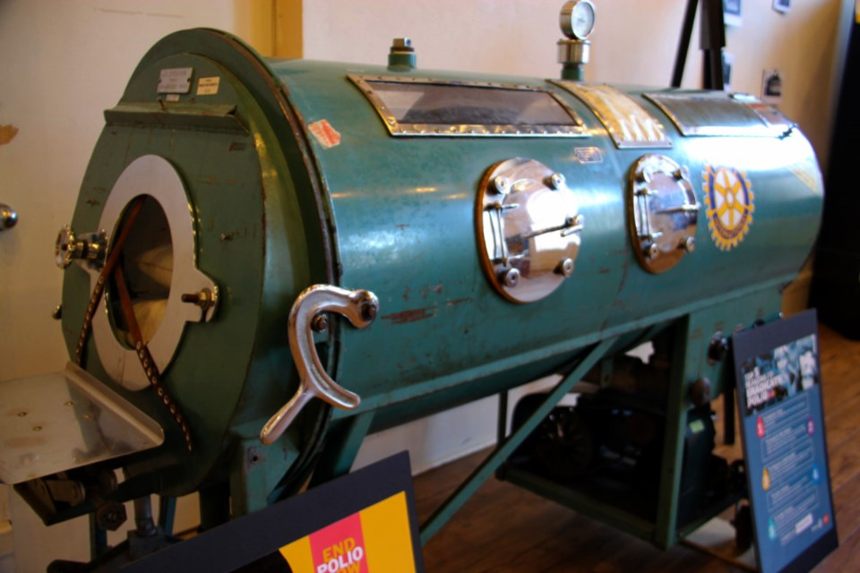 A device known as an iron lung, which was used in years past to treat polio, on loan to the Sault Ste. Marie Museum for its current exhibit celebrating Rotary's 100th anniversary, July 18, 2018, Darren Taylor/SooToday. The iron lung is on loan from a U.S. Rotary club for only two weeks during the exhibit, which continues at the museum until the fall.