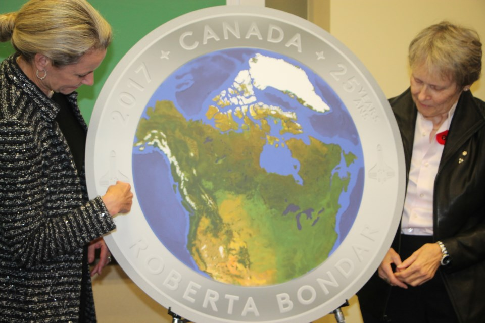 Dr. Roberta Bondar, right, joins Royal Canadian Mint president/CEO Sandra Hanington at the unveiling of an image of a special coin marking the 25th anniversary of Bondar's space shuttle flight, November 1, 2016. Darren Taylor/SooToday