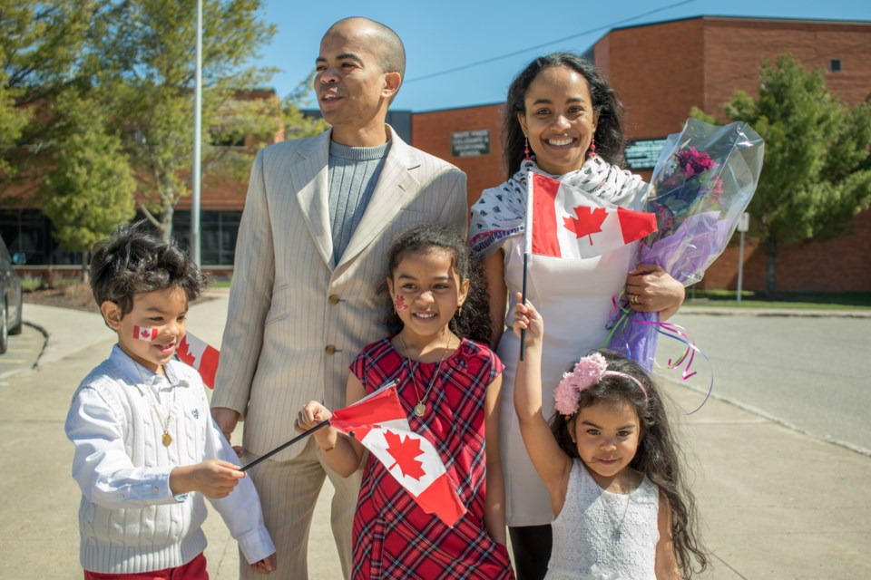 Members of the Laroulette family became Canadian citizens on Wednesday at a Citizenship Ceremony held at White Pines Collegiate & Vocational School. (From left) Damyen,6, Gilbert, Anne Danaëlle, 7, and mom Anne all joined youngest daughter Anne-Gayle, 4, as Canadian Citizens. Jeff Klassen/SooToday