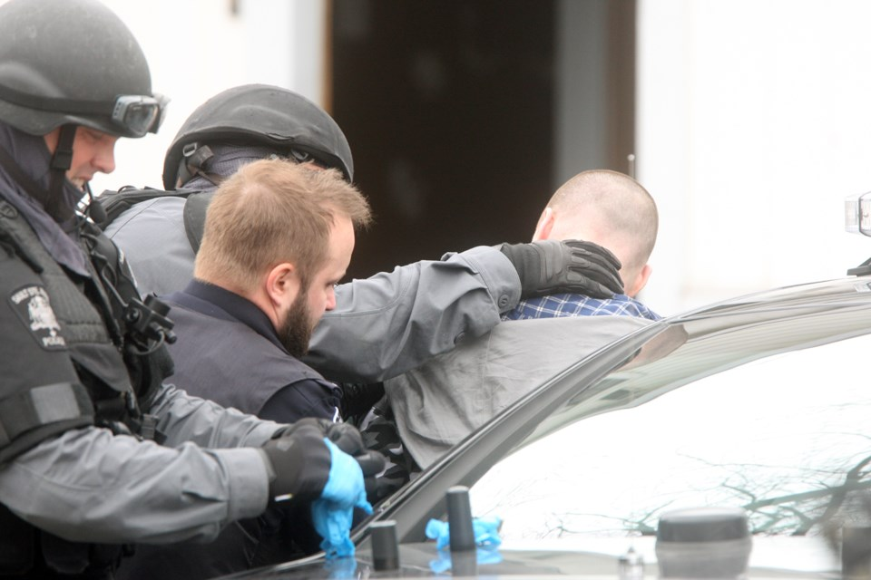 A man is taken into custody by officers with the Sault Ste. Marie Police Service on Apr. 21, 2017 on St. James Street. Kenneth Armstrong/SooToday