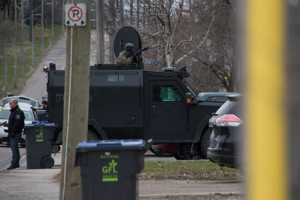 An armed police tactical unit entered a home on St. Georges Avenue East Thursday morning in an incident that lead to at least one arrest. A member of the Emergency Services Unit held position in an armoured vehicle with a gun pointed at the home as other officers conducted operations inside. Jeff Klassen/SooToday