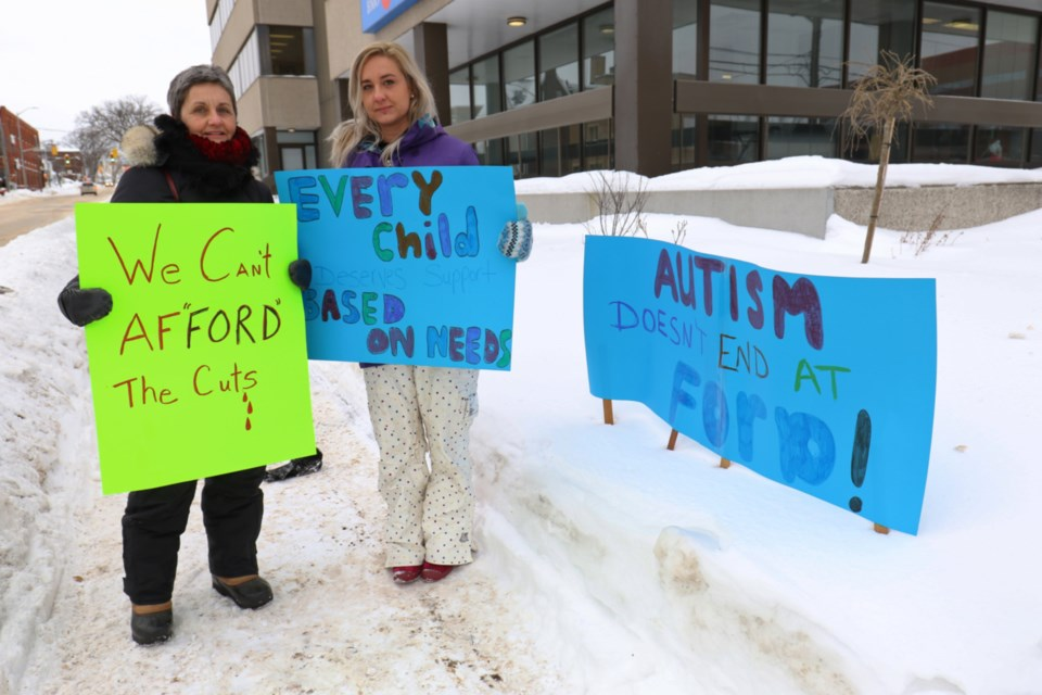 Ontario Autism Coalition regional coordinator Morgan Fiaschetti was joined by her mother, Diana McCartney, to protest changes to the province's autism program outside of MPP Ross Romano's office Thursday morning. James Hopkin/SooToday
