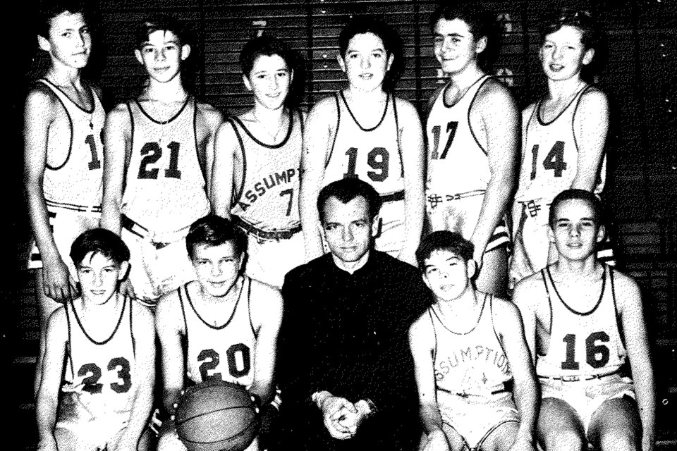 Father Marshall with 1955 bantam basketball team at Assumption College Catholic High School in Windsor, Ontario, Yearbook photo