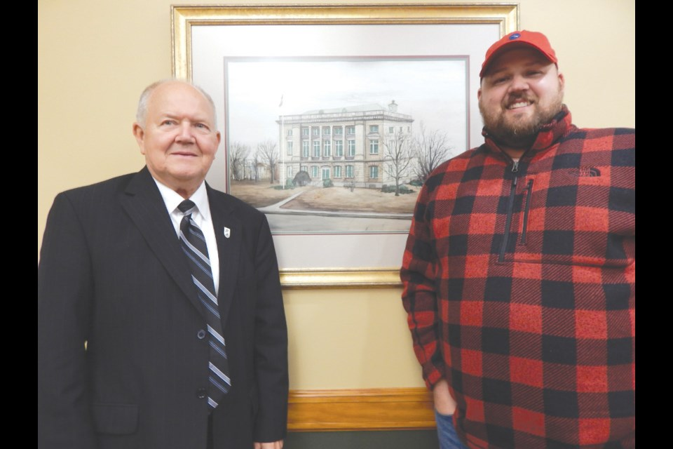 Former Sault, Michigan mayor and city commissioner Bill Lynn, at left, with son Michael. Photo courtesy of Scott Brand/The Sault News