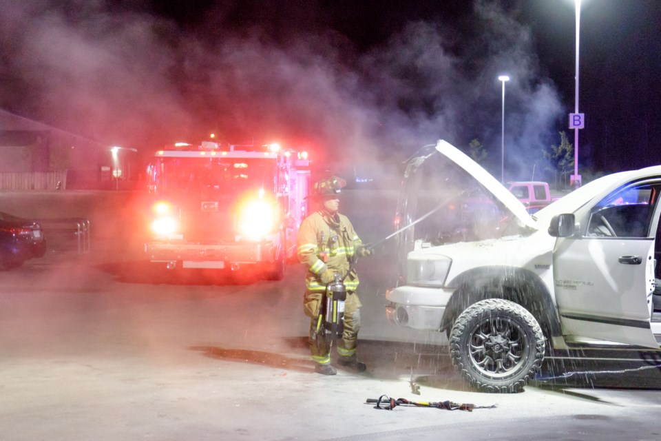 The Sault Ste. Marie Fire Department used a water-can fire extinguisher to put out a fire in the engine area of a white Dodge Ram pickup truck that was parked in front the new Meijer Supercentre in Sault, Mich. on Saturday, Sept. 30. Jeff Klassen/SooToday