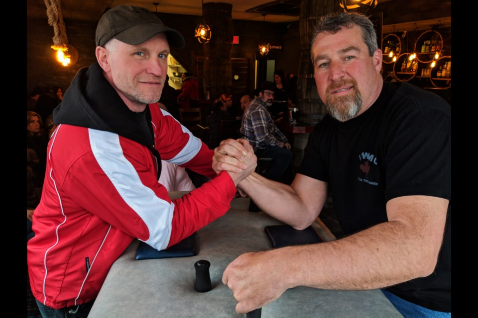 Marty Dimma, a local auto mechanic, and Cory Burke, a Sault College skilled trades instructor and Iron Workers Local 786 member, have been involved in arm wrestling for over 20 years. The Whisky Barrel Arm Wrestling Competition was held at the Gore Street pub April 13, 2019. Darren Taylor/SooToday