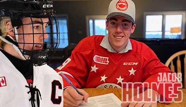 may14_holmes_signing