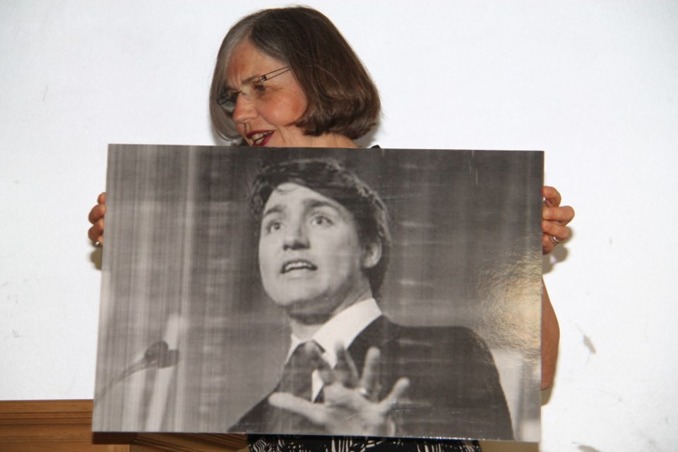 Linda Savory Gordon, Coalition for Algoma Passenger Trains (CAPT) spokesperson, with a photo of an invited but absent Prime Minister Justin Trudeau at a CAPT meeting at Sault Ste. Marie's Civic Centre, July 28, 2017.  Darren Taylor/SooToday