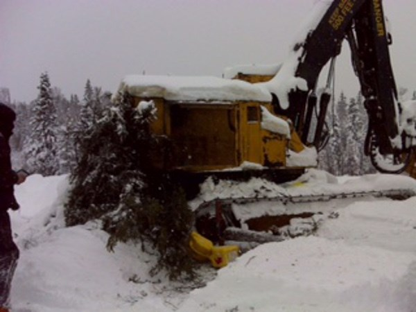 A logger took shelter under his broken down logging vehicle before being found by a Sault family and their friends Dec. 17, 2016. Photo supplied by Tanya Martin.