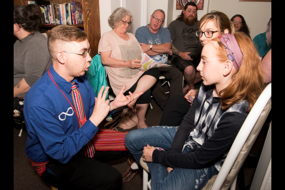 IT'S LIKE THIS – Josh Morin (left) explains to Lac Ste Anne resident Bella Parry how she would introduce herself in Michif. The two were among the 20-odd people who are taking part in a Michif language conversation club running all summer at Michif Cultural Connections.