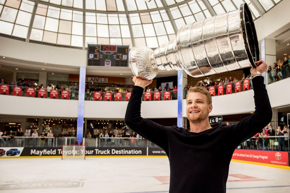 Colton Parayko of St. Albert hoists the Stanley Cup at centre ice of the Ice Palace in West Edmonton Mall during a break in action at the Brick Invitational Hockey Tournament on Wednesday,  July 3, 2019. Photo by Dan Riedlhuber / St. Albert Gazette
