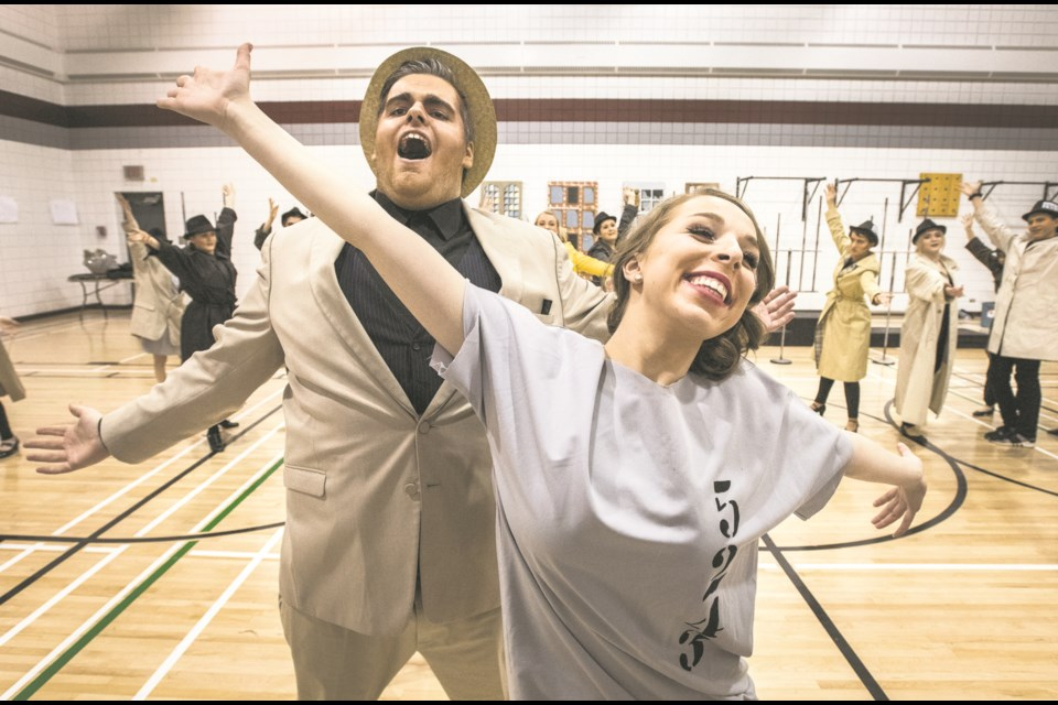 Connor Greenough as Billy Flynn, left, and Sarah Johnson as Roxie rehearse their roles in the musical stage production of Chicago with fellow Bellerose Composite High School players on Jan. 31. Both Greenough and Johnson have been nominated for Cappie awards.