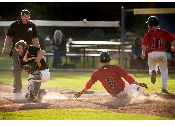 ARRIVING HOME –Zach Pollard (10) and Hayden Chies score as the throw from the outfield gets away from catcher Matt Orey of the Edmonton Primeaus in the North Central Alberta Baseball League game Tuesday at Legion Memorial Park. A triple off the bat of Tanner McLean-Poll produced the RBIs in the 7-5 win. Wednesday the Cardinals beat the host Stony Plain Mets 4-3 and Thursday's 7-4 decision against the Parkland Twins in St. Albert was the sixth victory in a row for the third-place Cardinals (11-6-1).  DAN RIEDLHUBER/St. Albert Gazette