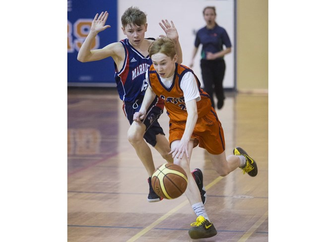 FAST BREAK – Austin Walter of the Lorne Akins Gators runs the floor with Liam Hanson giving chase for the Vincent J. Maloney Marauders in the St. Albert Physical Education Council semifinal Tuesday at Lorne Akins. The Gators (9-1) won 56-50 and will play the Richard S. Fowler Falcons (10-0) in the Tier I city final Tuesday at 7 p.m. at the SkyDome. Fowler, the defending champion, is 19-2 overall after defeating the William D. Cuts Crusaders 82-55 in semifinal action. Fowler is competing in its fifth final in six years and the Gators were the 2017 city champions.
