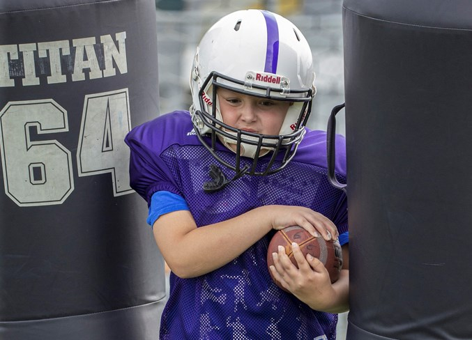 STRAIGHT AHEAD – Max Sponchia, 10, a returning player on the Vikings, punches through a set of tackle dummies during the first practice of the season Wednesday at Larry Olexiuk Field. The Vikings, Jaguars and Buccaneers are the St. Albert Minor Football Association atom teams in the Capital District Minor Football Association. CHRIS COLBOURNE/St. Albert Gazette