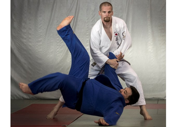 NATIONAL CHAMPION – Kyle Crowell of Morinville, a St. Albert Judo Club instructor and the veteran group one (30 to 35) minus-81 kilogram champion at the 2019 Canadian Open Judo Championships, throws club member Jerry Simundza, a bronze medallist in the plus-100 kg. division, at Monday's training session. DAN RIEDLHUBER/St. Albert Gazette